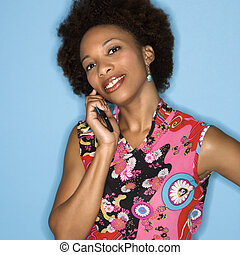 Retro woman on cellphone - Woman with afro wearing vintage...
