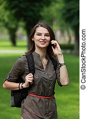 Young Woman on the Phone in a Park
