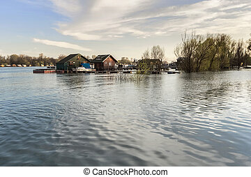Early spring photograph shot at dusk of risen Sava river...