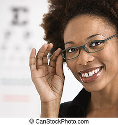 Woman getting eyeglasses - Portrait of woman with afro...