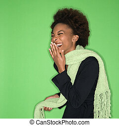 Laughing woman - Pretty woman wearing green scarf laughing...