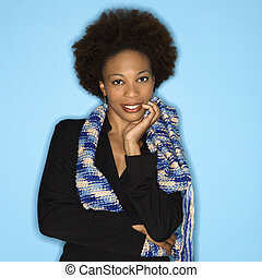 Woman with afro - Pretty woman smiling against blue...