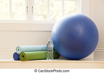 Gym still life - Balance ball, exercise mats and bottled...