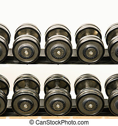 Barbells on rack - Hand weights on rack at health club.