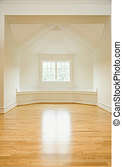 Empty room in house with sunlight coming through window on...