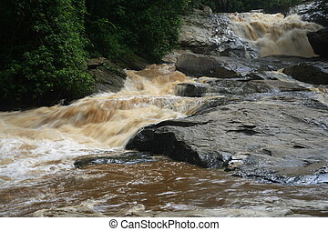 Cataract after rain, red water river