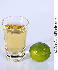 Tequila Shot with Whole Green Lime on Reflective Foreground...