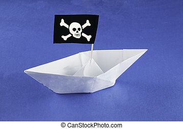 Pirate ship - Paper pirate ship with flag over blue paper...