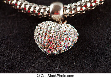 Heart - Jewel in shape of heart over black background