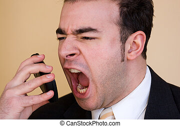 Furious Business Man - A business man is furiously screaming...