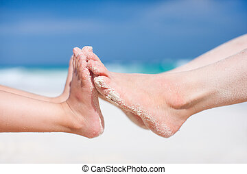 Feet on tropical sand - Close up of mother and daughter feet...