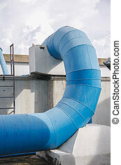 pipes of an irrigation water - big blue steel pipes of an...