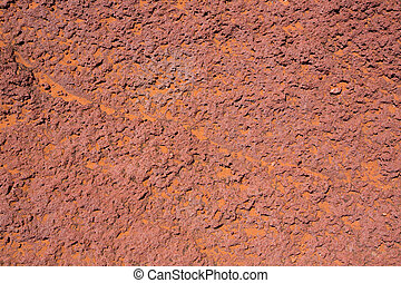 Arizona red stone detail with orange desert sand near...
