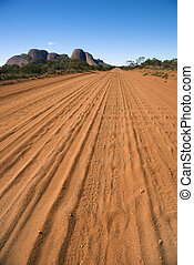Dirt road Kata Tjuta - Dirt road with tire tracks in Uluru...