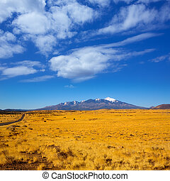Arizona Highway 89 US with view of snow Humphreys peak -...