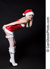 Sexy Woman Santa Claus is leaning forward and his hands...