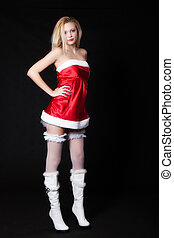 Sexy Woman Santa Claus standing with hands on her hips, with...