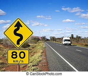 Australia road travel - Van on asphalt two lane road in...