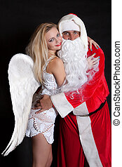 Santa Claus man and woman angel - Man Santa Claus hugging a...