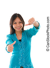Cute young Muslim girl giving a thumb up sign over white background, focus on thumb.