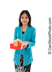 traditional young malay girl holding a gift