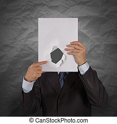 businessman hand show black cover book with crumpled recycle paper background  as concept