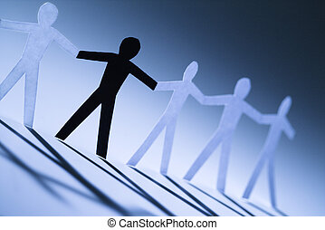Affirmative action - One black cutout paper person holding...
