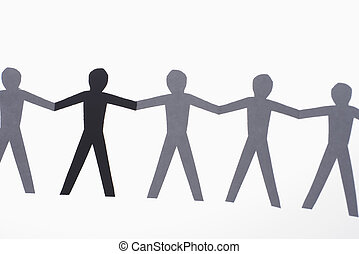 Multiethnic people - One black cutout paper person holding...