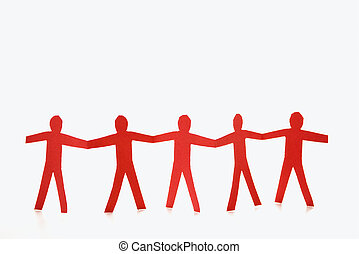 Red people holding hands - Red cutout paper men standing...