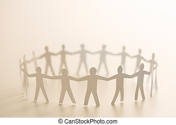 People forming circle - Cutout paper people standing in...