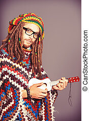 hippie young - Portrait of a hippie young man playing his...
