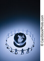 World peace - Cutout paper people standing around globe...