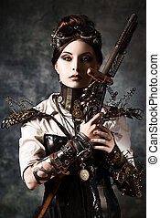 gothic - Portrait of a beautiful steampunk woman holding a...