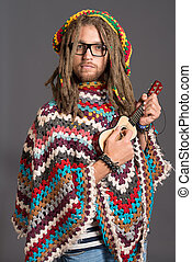 guitar man - Portrait of a hippie young man playing his...