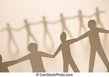 People holding hands - Cutout paper men standing holding...