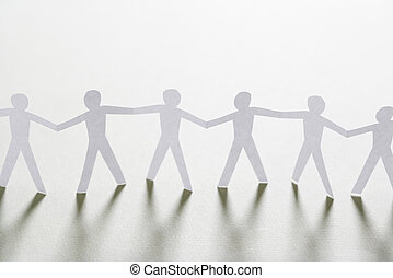 Community - Cutout paper men standing holding hands