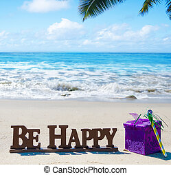"Sign ""Be Happy"" with Birthday decorations on the beach -..."