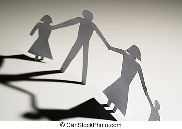 Family together - Paper cutout family of four standing...