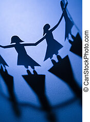 Women holding hands - Cutout paper females standing holding...