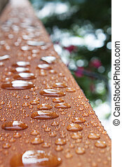Deck rail after rain - Lengthwise view in selective focus,...