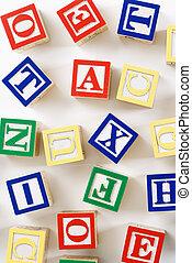 Alphabet toy blocks. - Alphabet building block toys...
