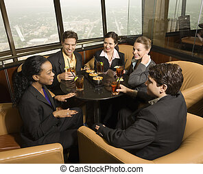 Business people eating - Ethnically diverse businesspeople...