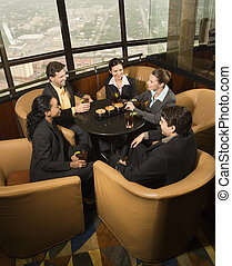 Business people in restaurant.