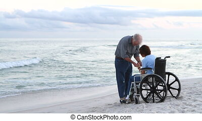 Praying For Healing - Elderly man and woman pray for...