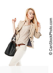 Young excited woman looking at the shop window