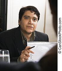 Businessman in meeting.