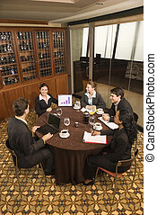 Business meeting - High angle of diverse group of...