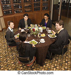 Businesspeople eating. - High angle of group of...
