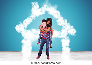 in love couple standing in a house made of clouds