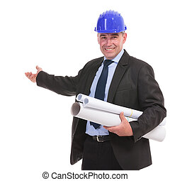 portrait of a senior engineer presenting something and...